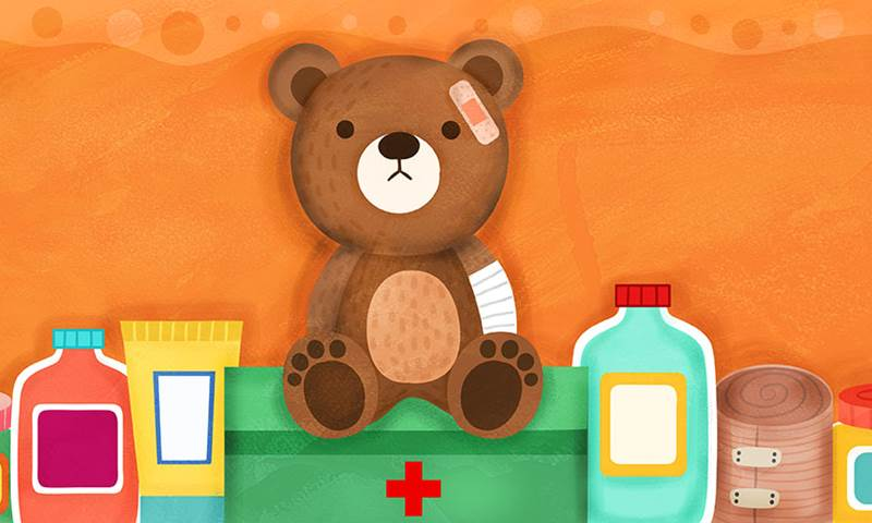 teddy bear with plaster on his head and a bandage wrapped around his arm. Next to him are various medicine bottles.